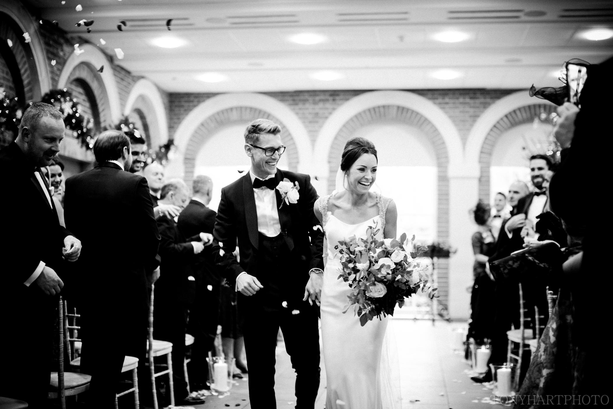 The Best Wedding Photographs of 2017 - Christie & Chris just after getting married at Great Fosters