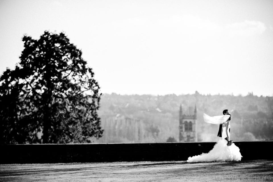 Sophie's veil blowing in the wind at Farnham Castle