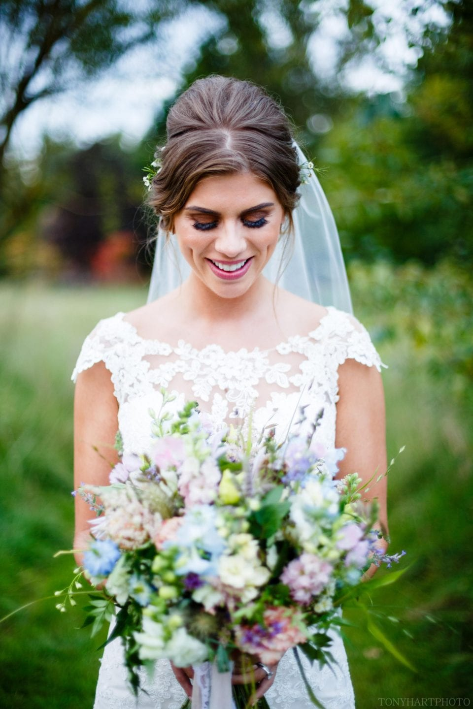 Emma admiring her beautiful bouquet at Rivervale Barn