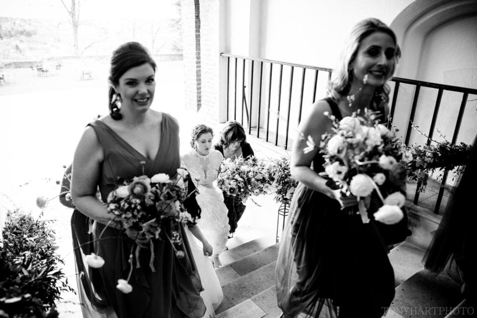 Marissa climbing the Foxes Steps at Farnham Castle on her way to her wedding ceremony!