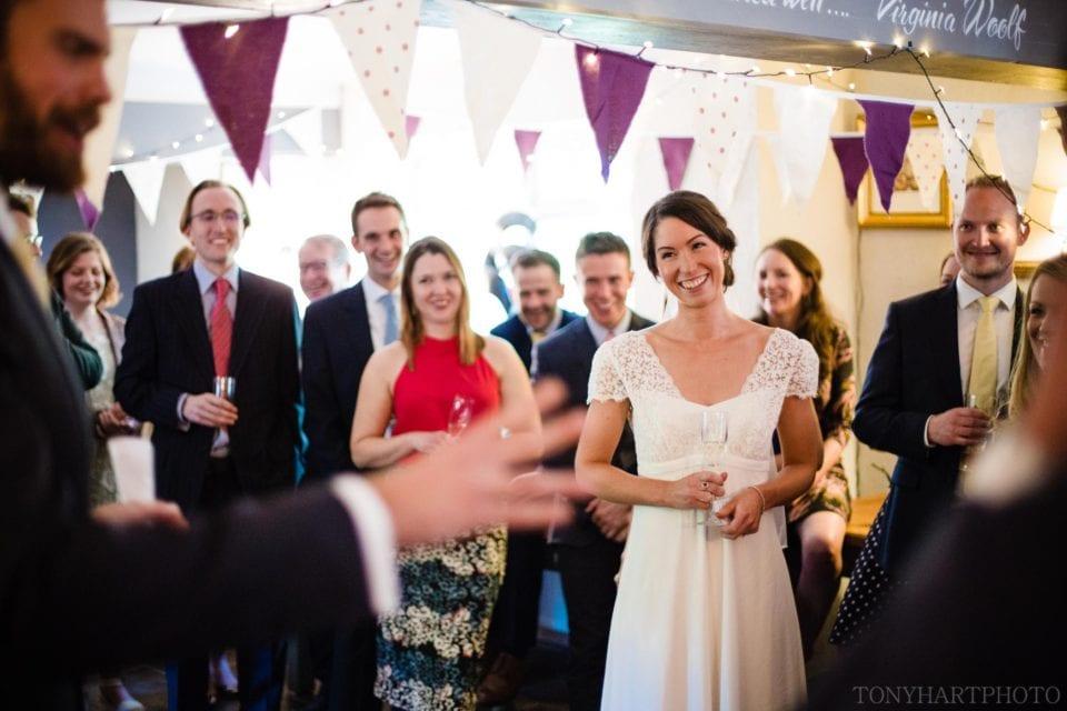 Liz listening to her new husband's wedding speech at The Bluebell Pub in Dockenfield