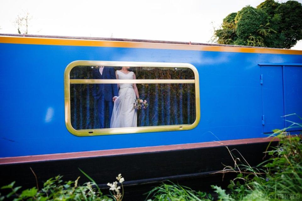 Shona & Alex reflected in a narrowboat window