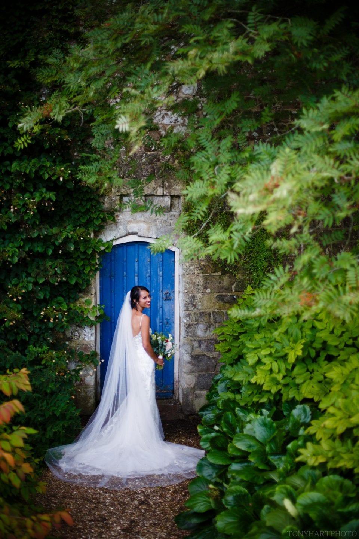 Nikki next to the blue door at Farnham Castle
