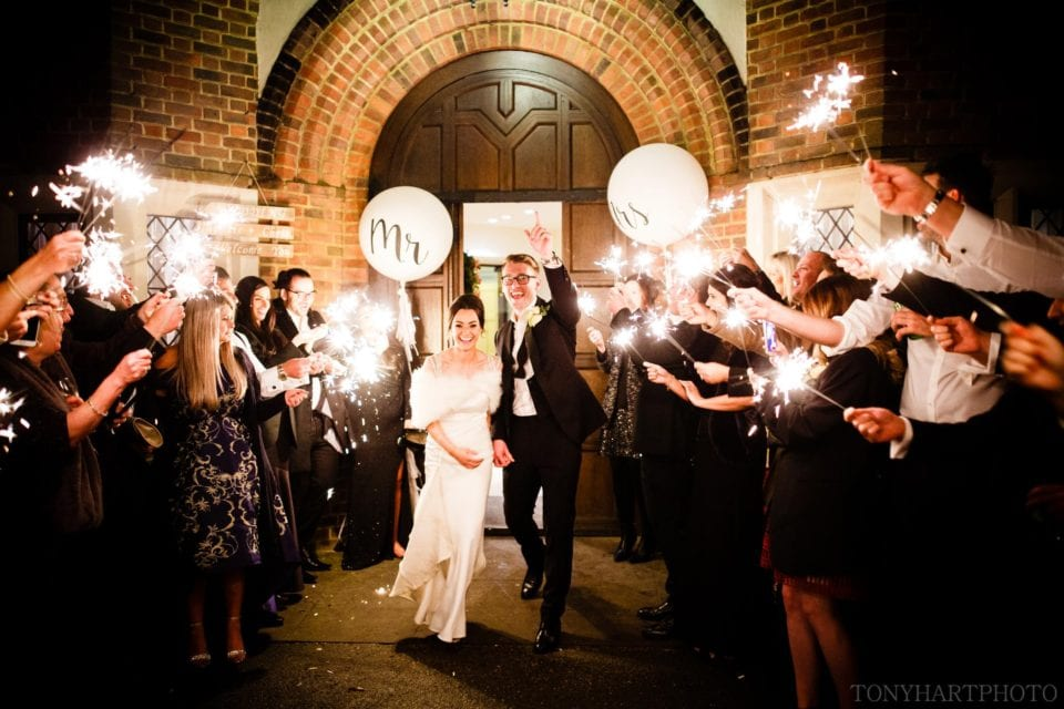 The Best Wedding Photos of 2017 - Christie & Chris' amazing sparkler send off featuring giant Mr & Mrs' Balloons at the end of their Great Fosters wedding