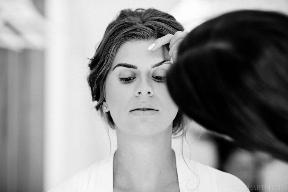 Emma having her makeup done in the bridal prep room at Rivervale Barn