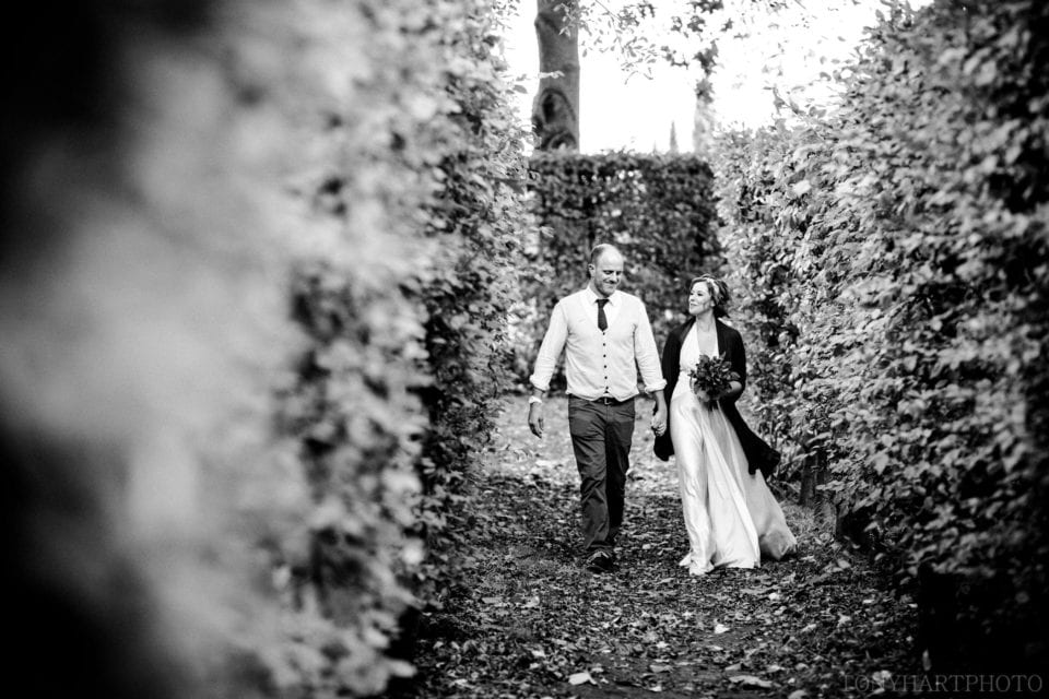Emma & Tom took time for a quiet stroll on their wedding day at West Green House