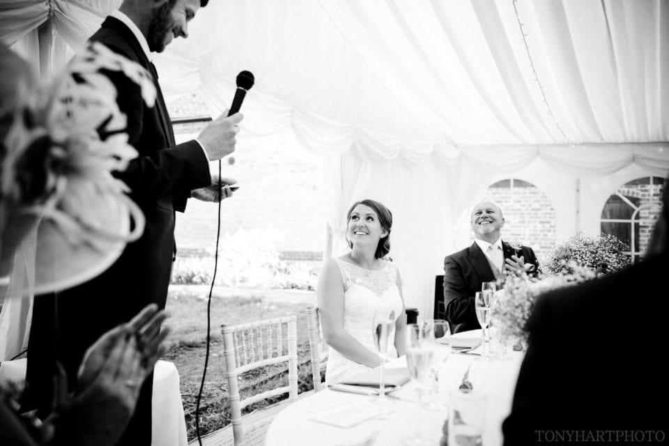 Tazz listening to Tim's excellent Groom speech during their wedding at Crowmarsh Battle Farm