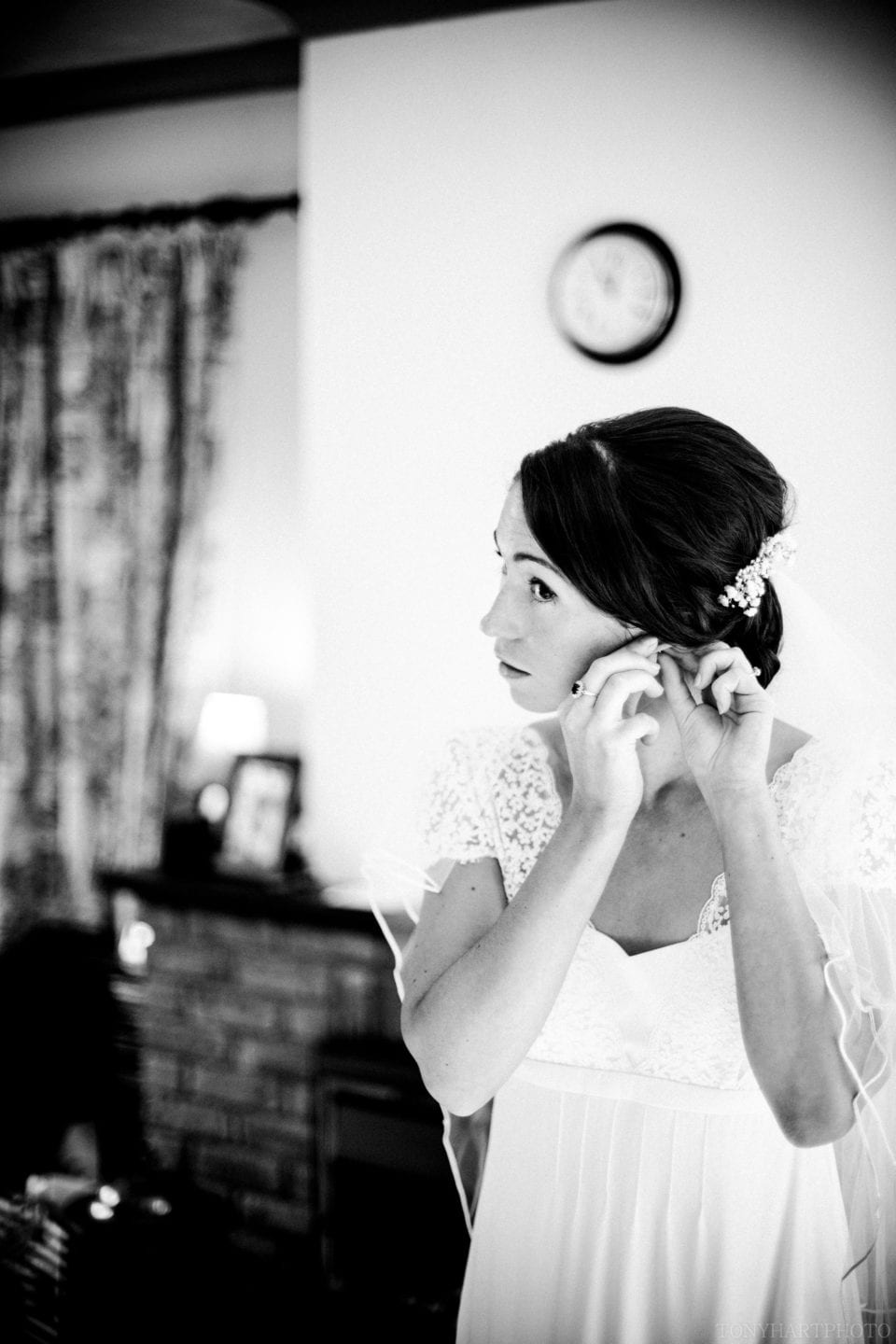Liz putting her earrings on at home before heading to Guildford to get married to Peter