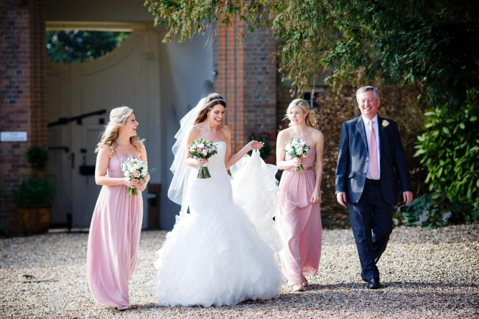 Sophie and her bridesmaids making their way across from the Gatehouse to the Lantern Hall at Farnham Castle