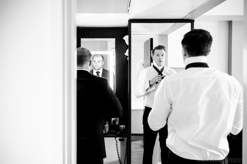 Groom Joe and his best man getting suited and booted before his wedding to Jess at Silchester House