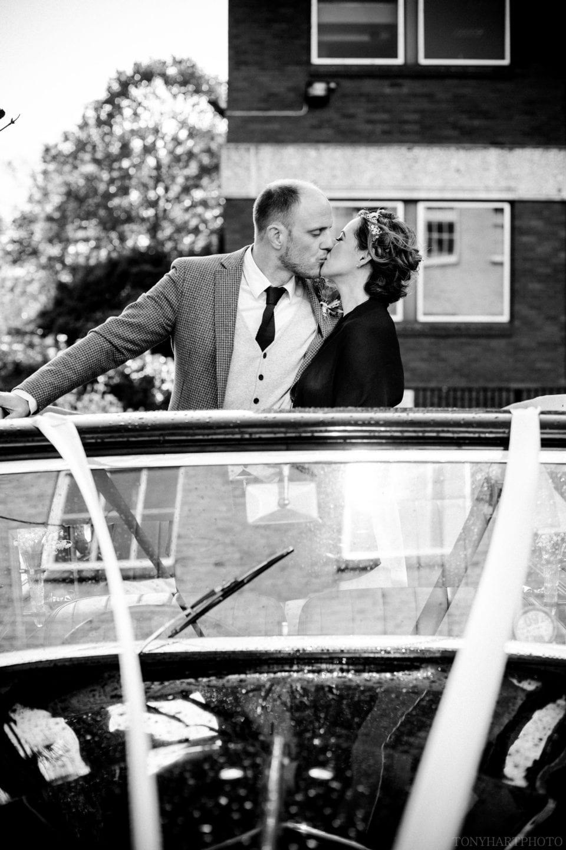 Emma & Tom having a post wedding pash in the wedding car!