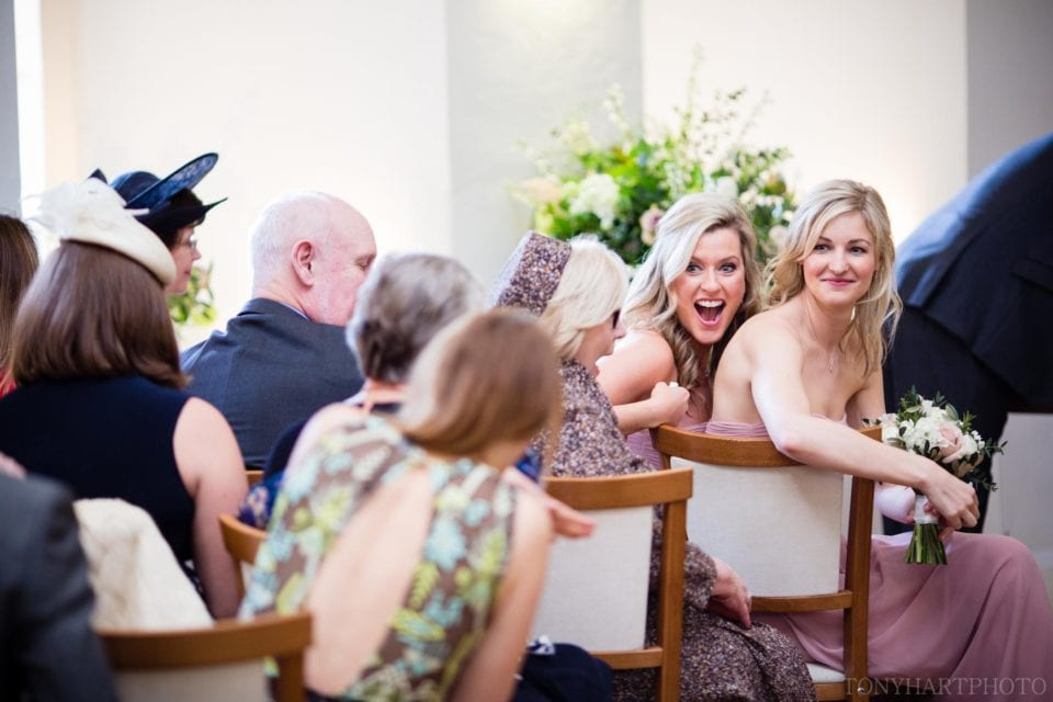 Sophie's sister doing 'amazement' during the ceremony at Farnham Castle