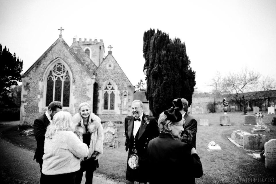 Wedding guests outside Peper Harrow church