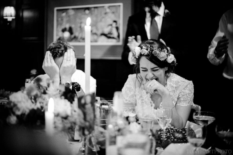 Ali & Nic in fits of laughter during the wedding speeches at Ramster Hall