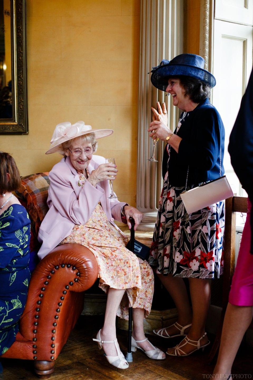 Nan having a giggle during Penny & James' wedding reception at Hampton Court House