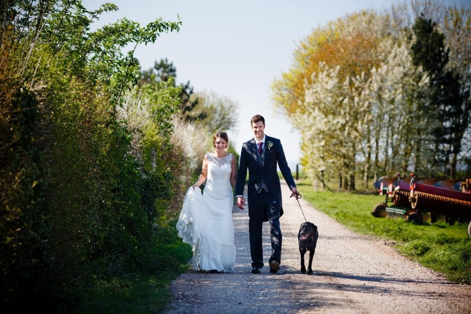 Tazz & Tim taking Frosbury for a walk on their wedding day in Oxfordshire