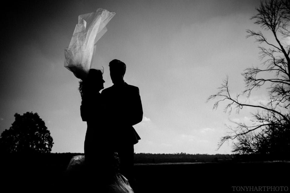 Sophie and Matt silhouetted against the sky at Farnham Castle