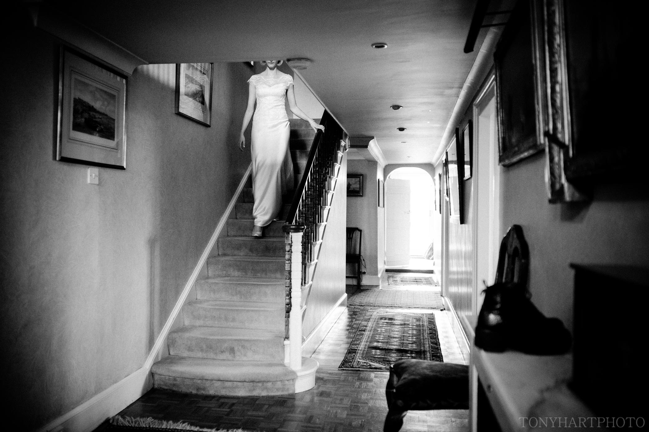 Venetia descending the stairs in her bespoke Emma Victoria Payne wedding dress