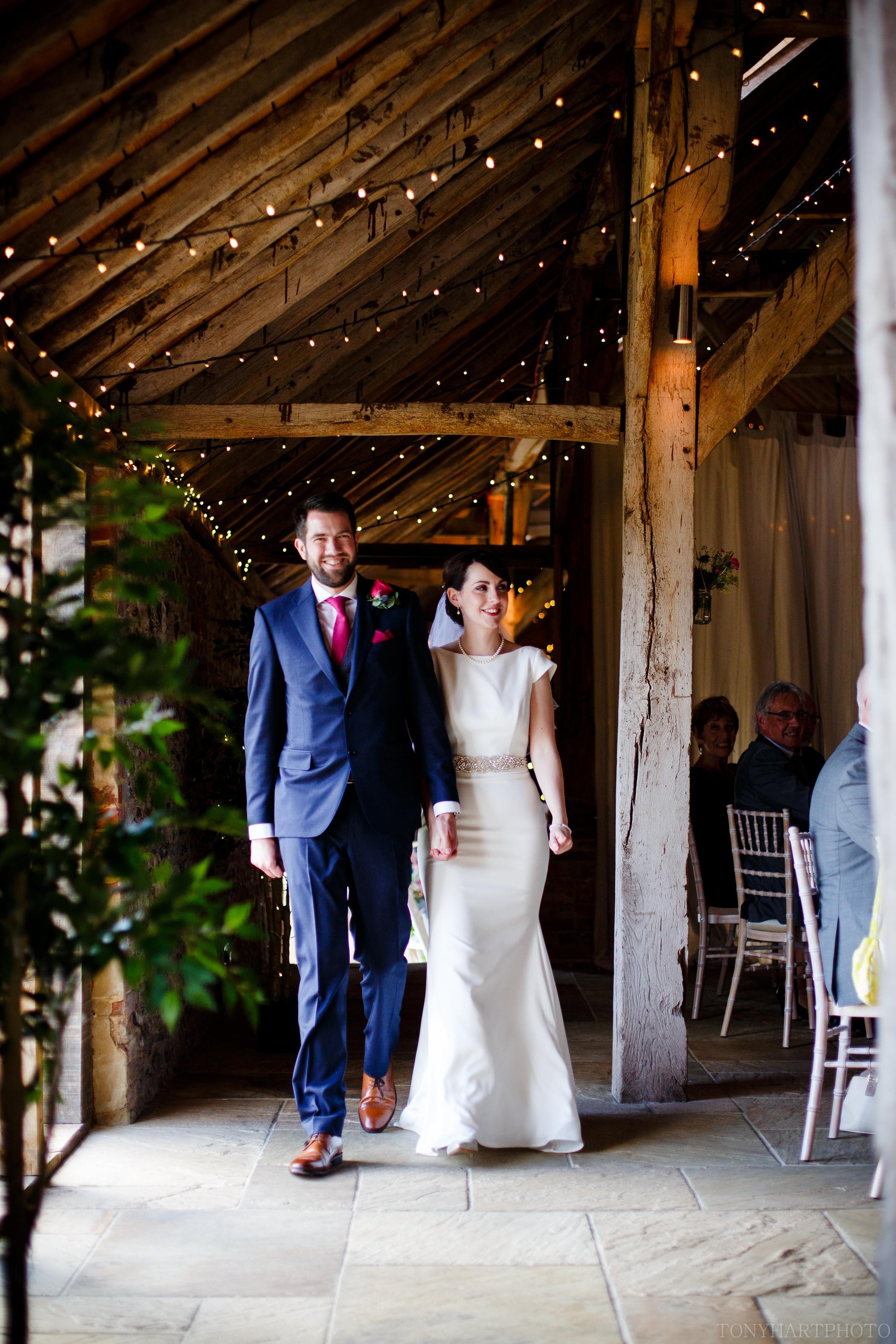 Phil and Emma enter their wedding breakfast