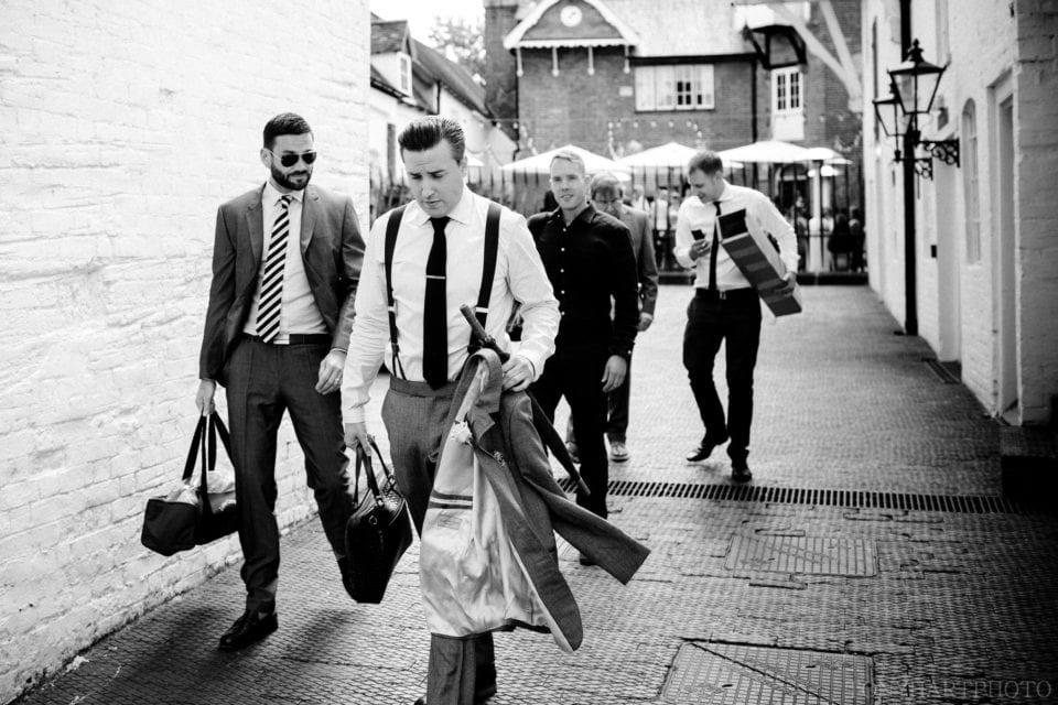 The groom and his groomsmen walk through Henley