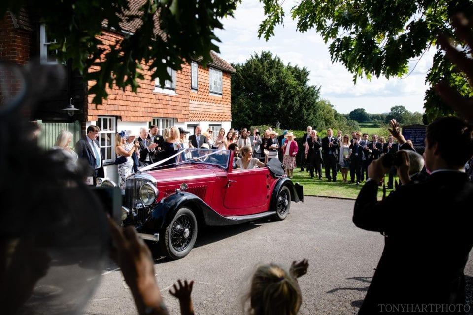 Bride & Groom departing church in vintage Bentley