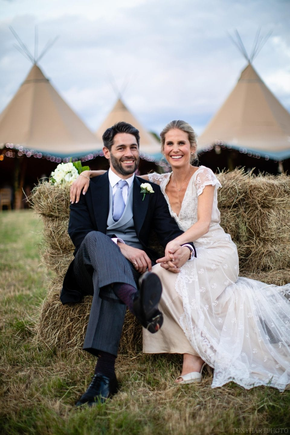 Grace & Jumbo pictured outside their tipi wedding in West Sussex