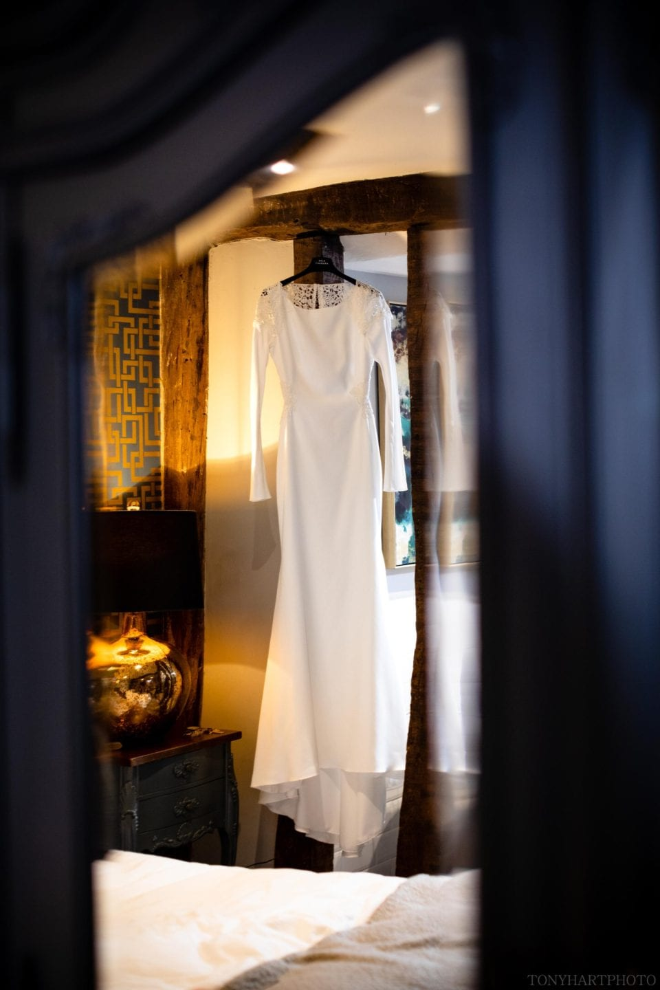 Anna's beautiful Rime Arodaky gown hanging in the Stratford Townhouse