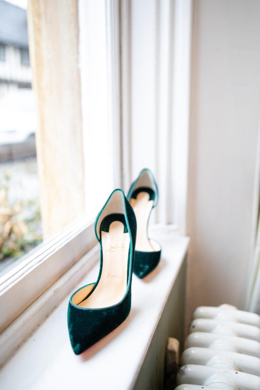 Anna's beautiful green velvet Christian Louboutin shoes.