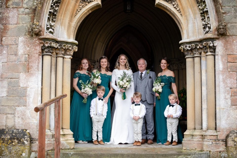 Anna, her bridesmaids, her Dad and the pageboys. The bride wears a Rime Arodaky dress while the bridesmaids wear Whistles maxi dresses.