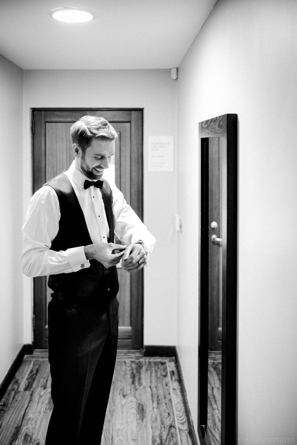 James getting his suit on - Northbrook Park Wedding Photography