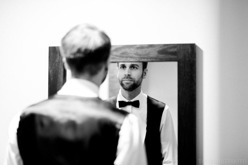 Groom James checking his bowtie