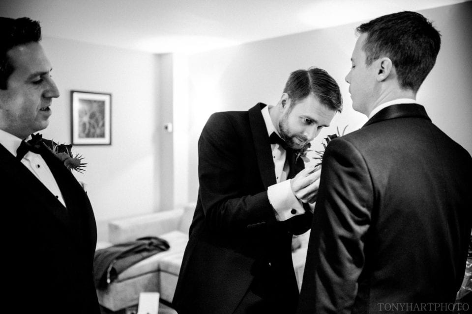 Northbrook Park Wedding Photography - Groom James sorts out his best man's buttonhole