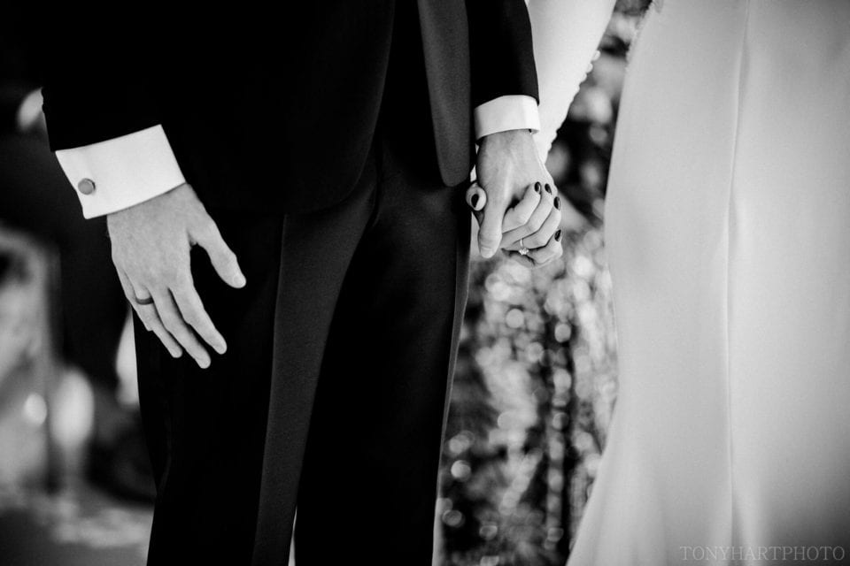 Holding hands during the ceremony in The Vine Room