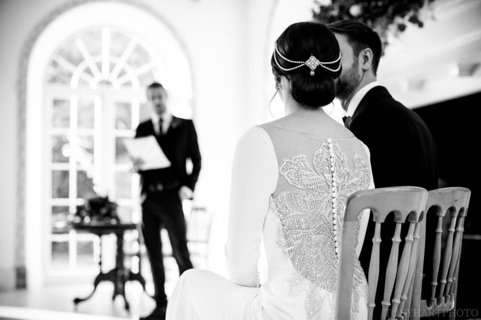 Northbrook Park Wedding Photography - Ceremony reading in The Vine Room