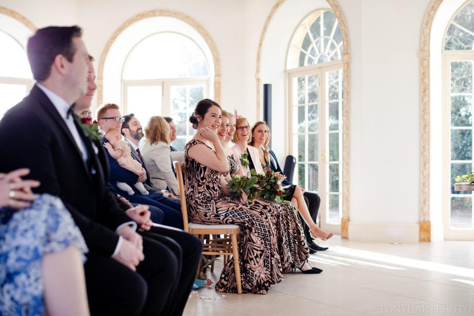 Northbrook Park Wedding Photography - Guests watch the ceremony