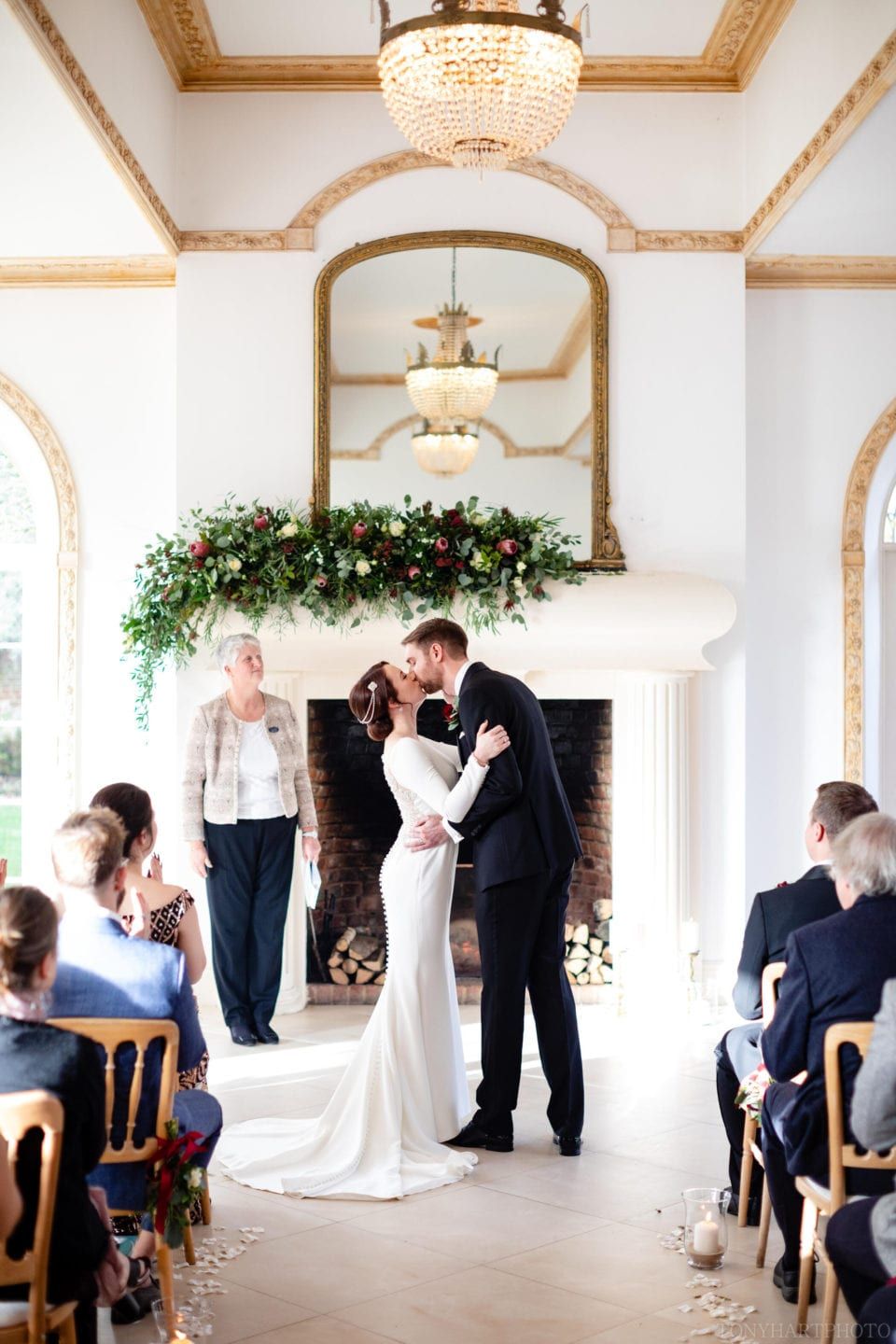Northbrook Park Wedding Photography - James & Jemima's First Kiss in The Vine Room