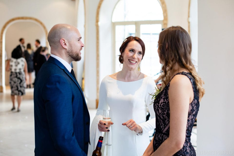 Northbrook Park Wedding Photography - Jemima chatting to her guests