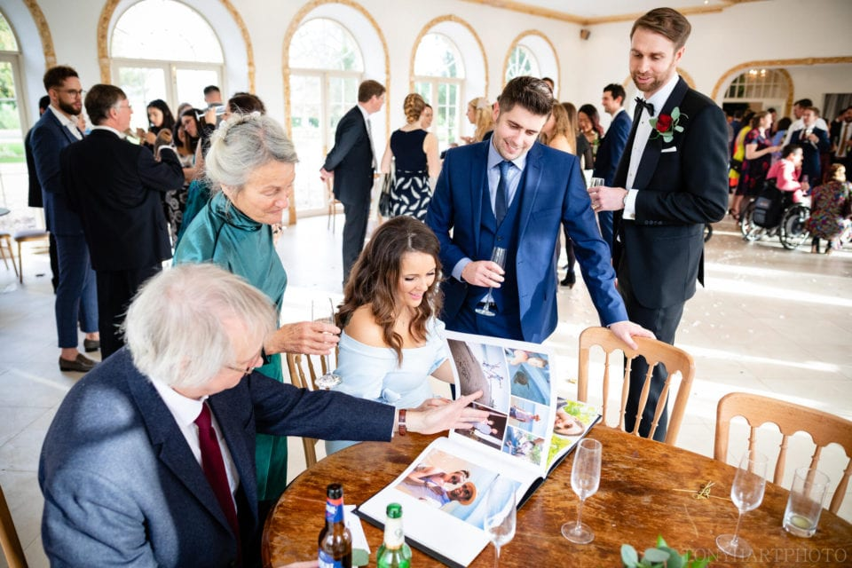 Guests look through an album of photographs