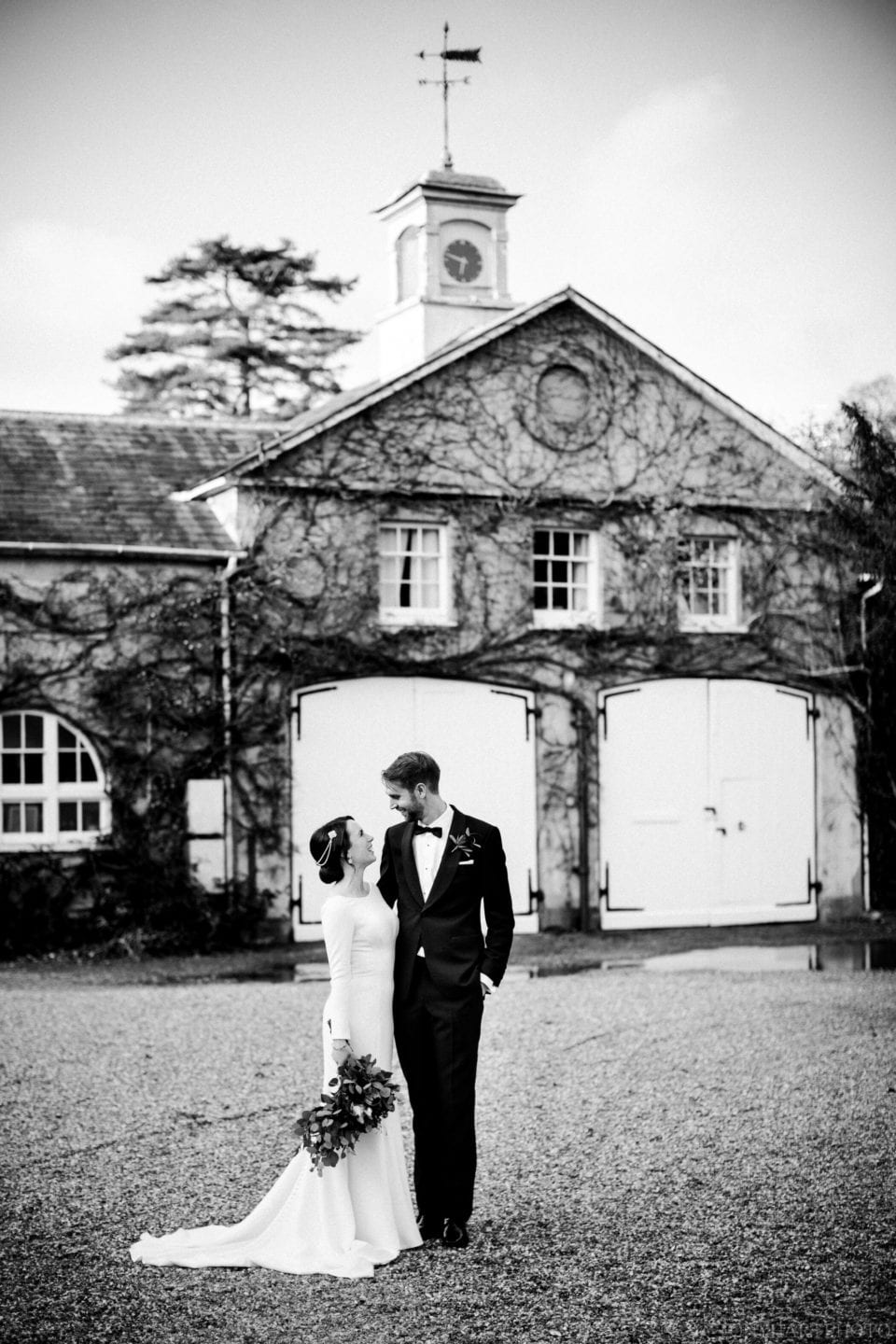 Black and white wedding portrait outside at Northbrook Park