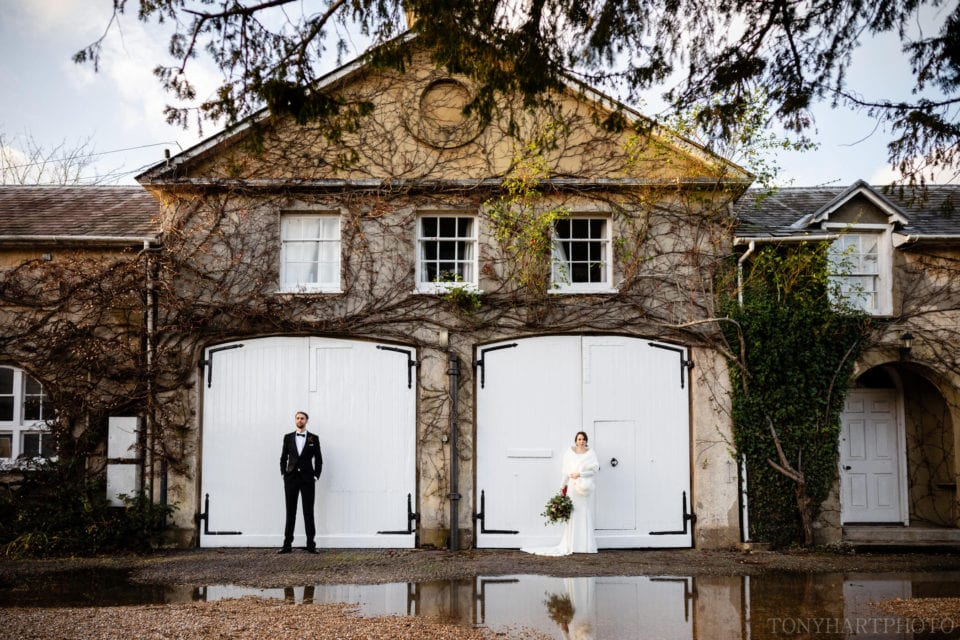Making use of the architecture during portraits at a Northbrook Park wedding
