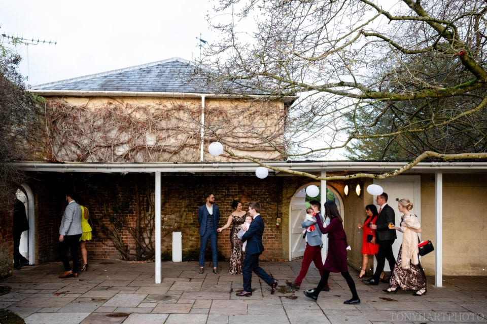 Guests cross to the Orangery at Northbrook Park