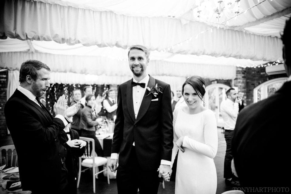 Northbrook Park Wedding Photography - James & Jemima making their entrance into their wedding breakfast