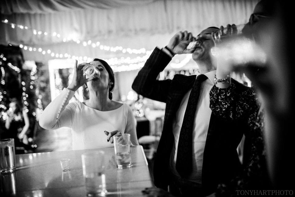 Northbrook Park Wedding Photography - Shots at the bar