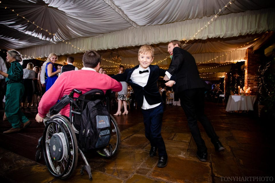Northbrook Park Wedding Photography - Everyone got on the dance floor. Wheelchair users and this pageboy who knew how to floss better than anyone I've ever seen