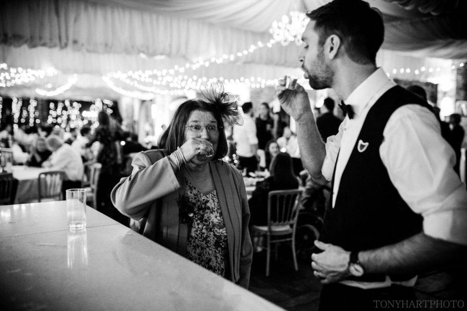 Groom and his Mum do shots at the bar!