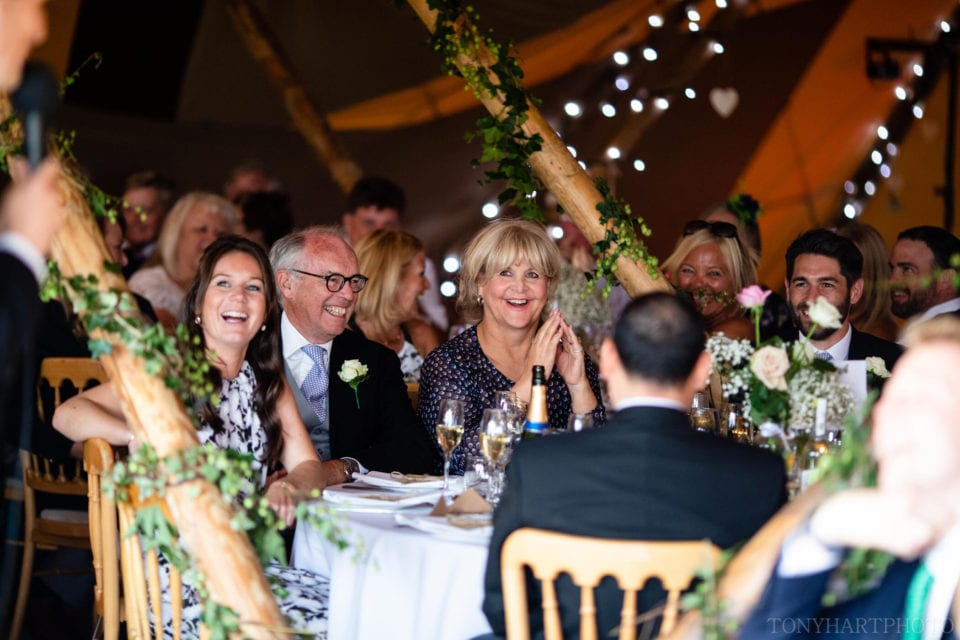 Laughter from the guests during the tipi wedding