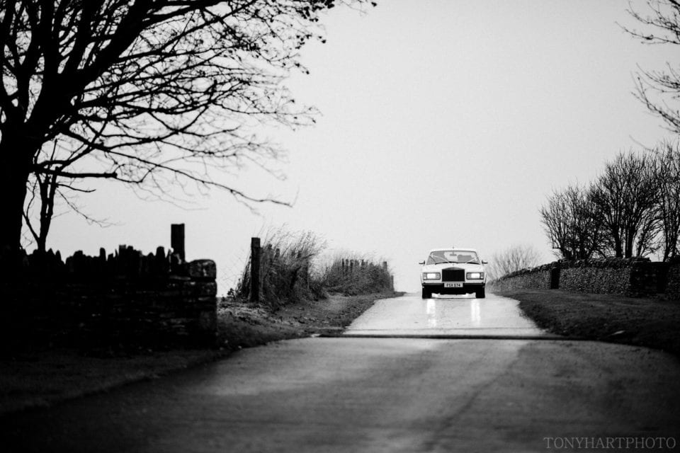 Bridal car arriving at Cripps Stone Barn