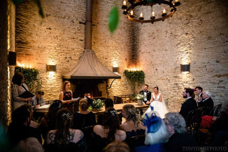 Reading during the wedding ceremony at Stone Barn