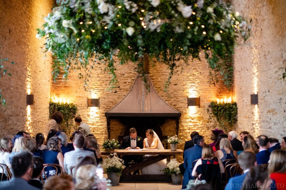 Signing the register in front of the fire at Stone Barn