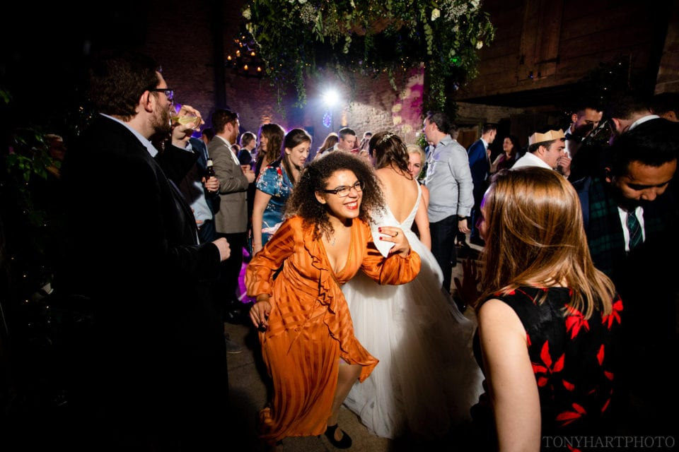 Wedding guests party in the Stone Barn